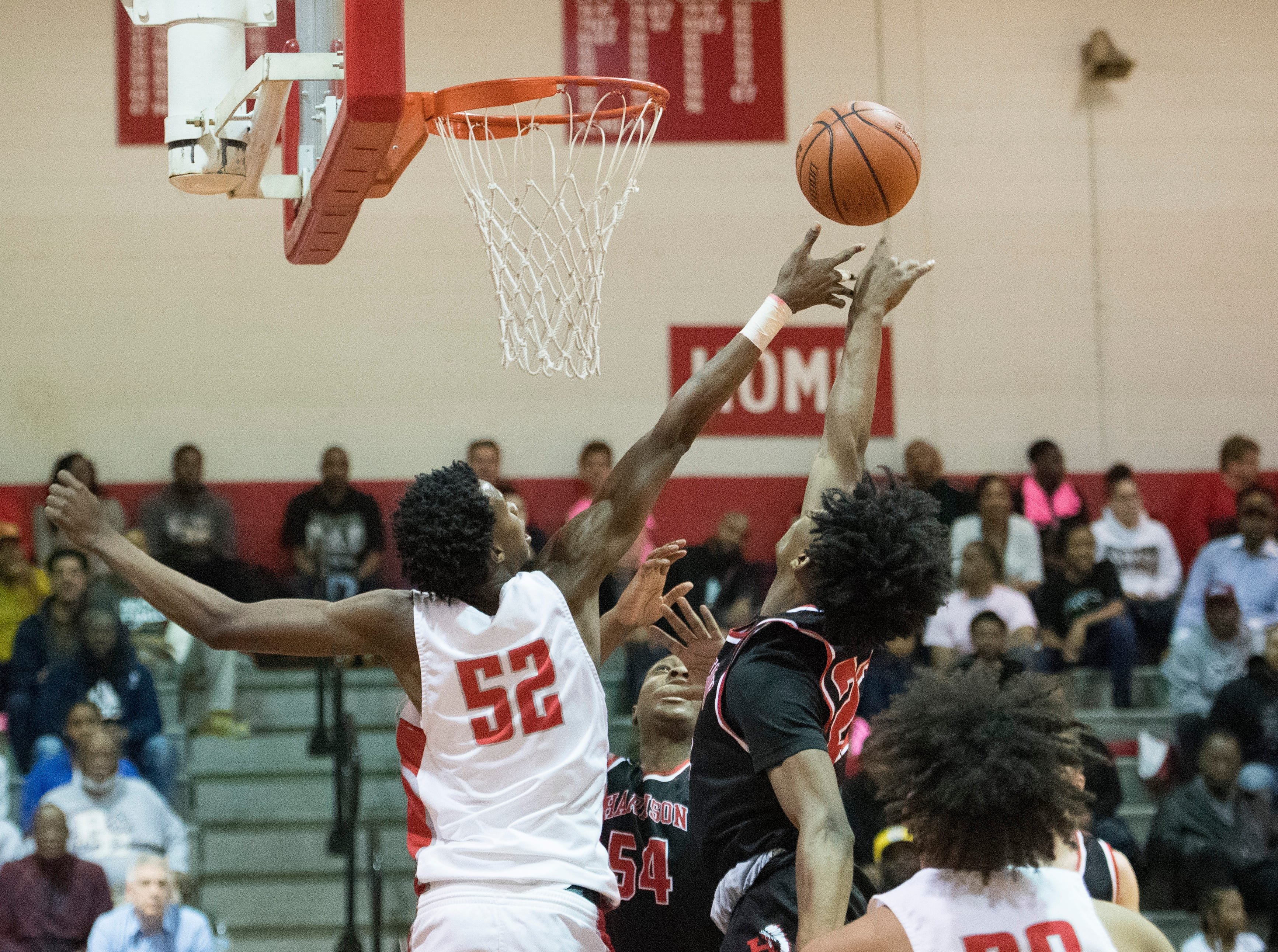 Bosse's Kiyron Powell (52) reaches for a rebound during the Harrison vs Bosse game at Bosse High School Tuesday, Feb. 12, 2019.