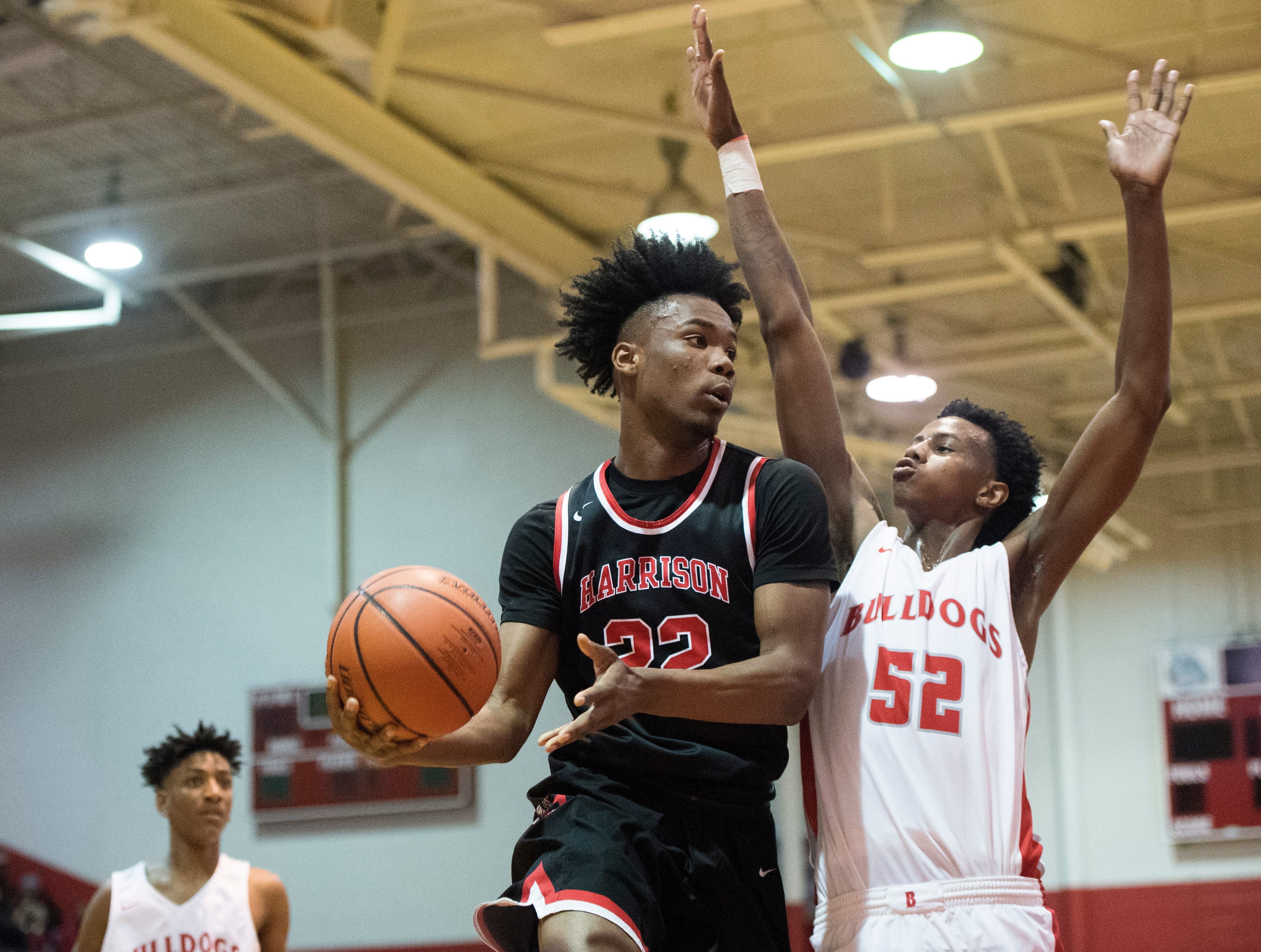 Harrison's Isaiah Edinburgh (22) is forced to pass the ball as he goes up to the basket during the Harrison vs Bosse game at Bosse High School Tuesday, Feb. 12, 2019. The Bosse Bulldogs won 74-56.