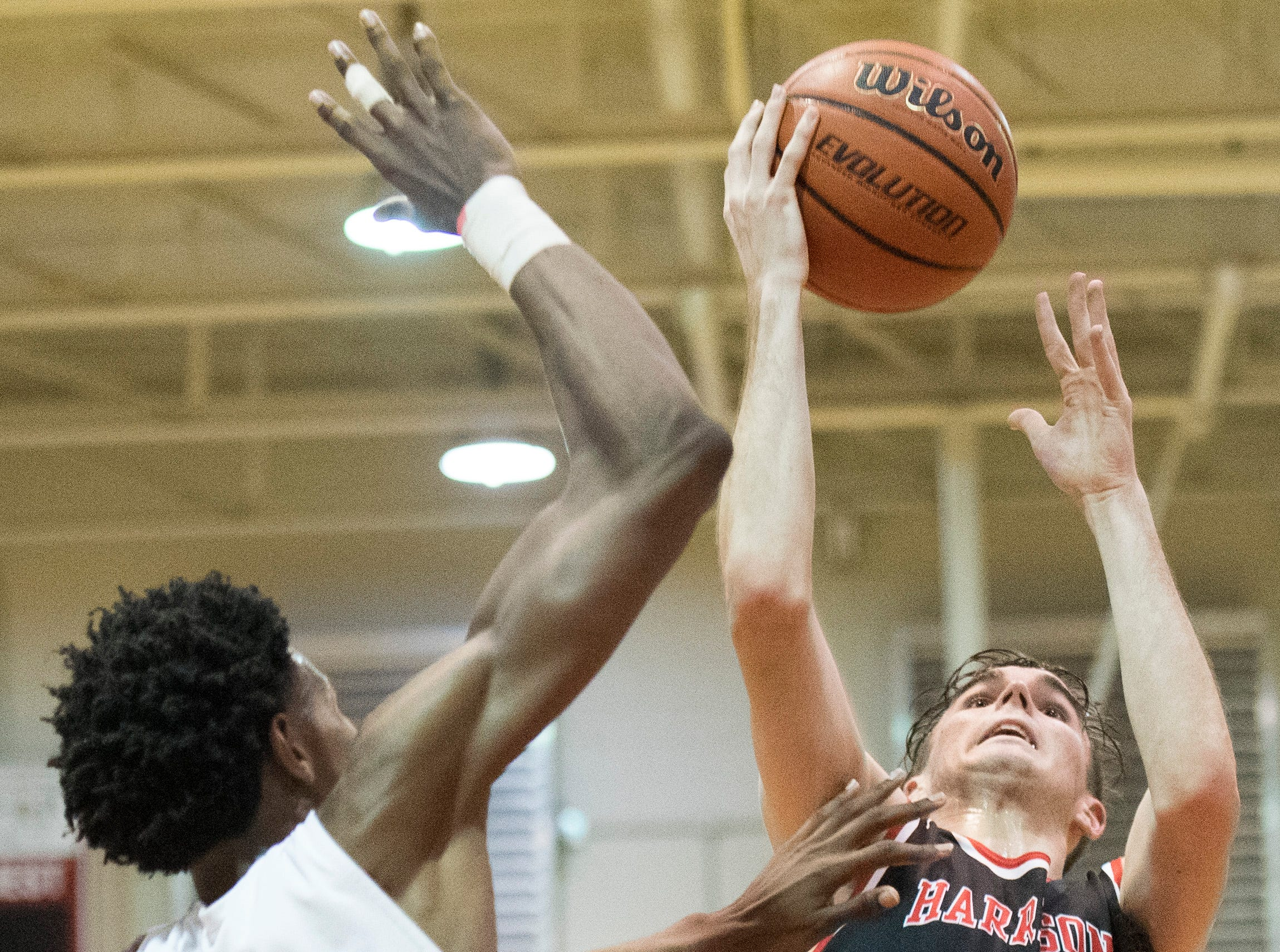 Harrison's Mason Bost (12) takes a shot during the Harrison vs Bosse game at Bosse High School Tuesday, Feb. 12, 2019. The Bosse Bulldogs won 74-56.