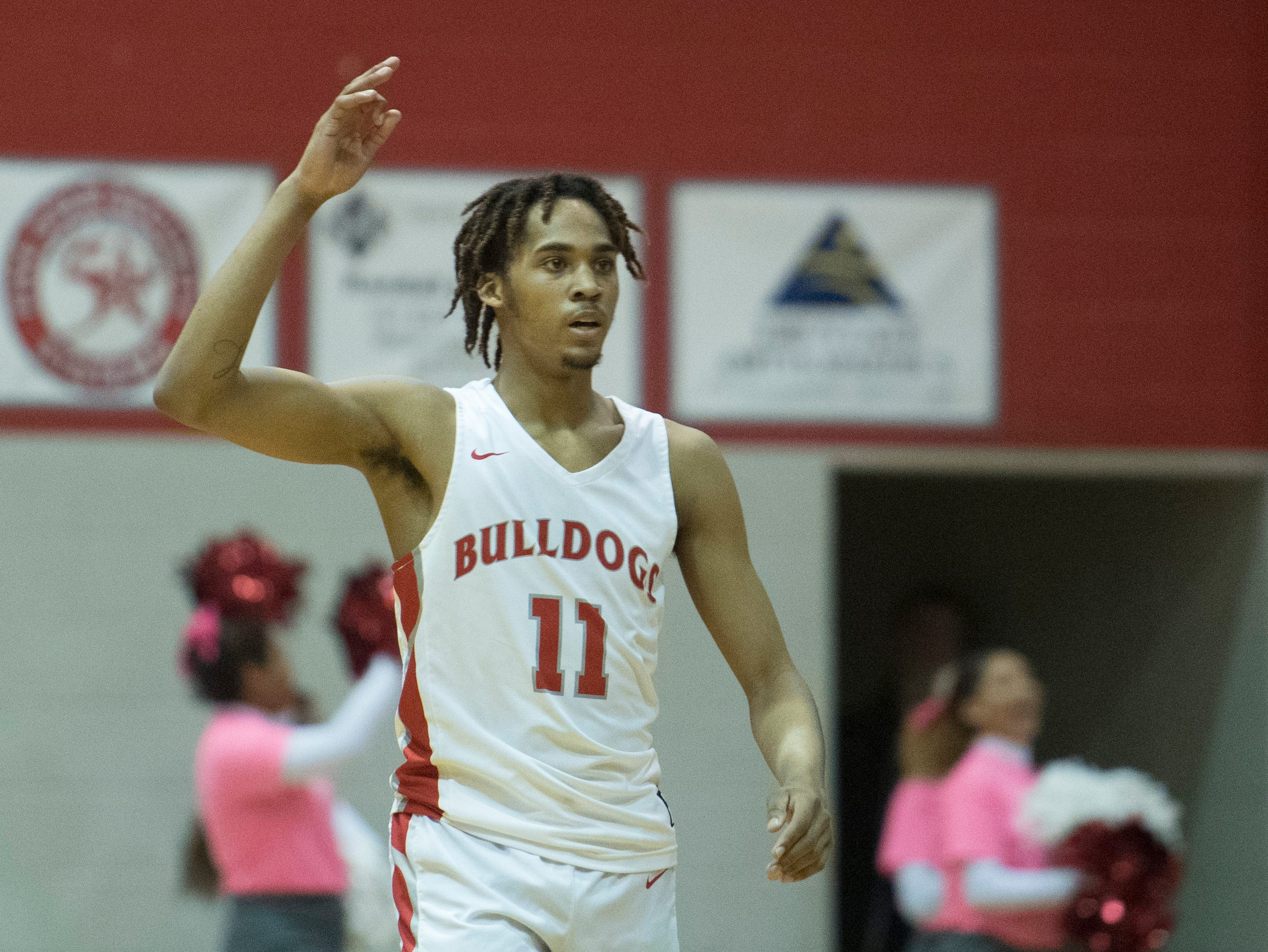 Bosse's George Madison (11) reacts after Bosse's Kolten Sanford (45) sinks a 3-point basket during the Harrison vs Bosse game at Bosse High School Tuesday, Feb. 12, 2019. The Bosse Bulldogs won 74-56.
