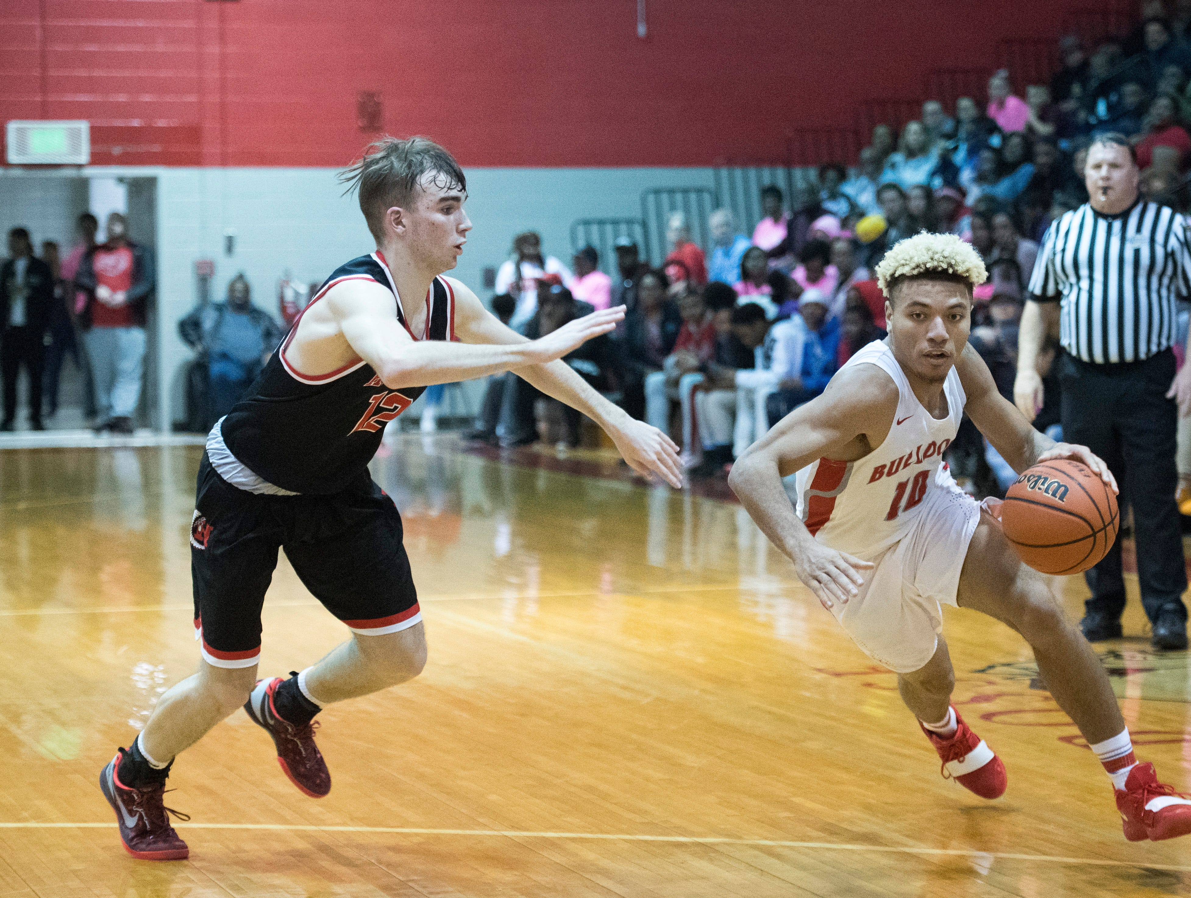 Bosse's Javen Layne (10) rushes to the basket during the Harrison vs Bosse game at Bosse High School Tuesday, Feb. 12, 2019. The Bosse Bulldogs won 74-56.