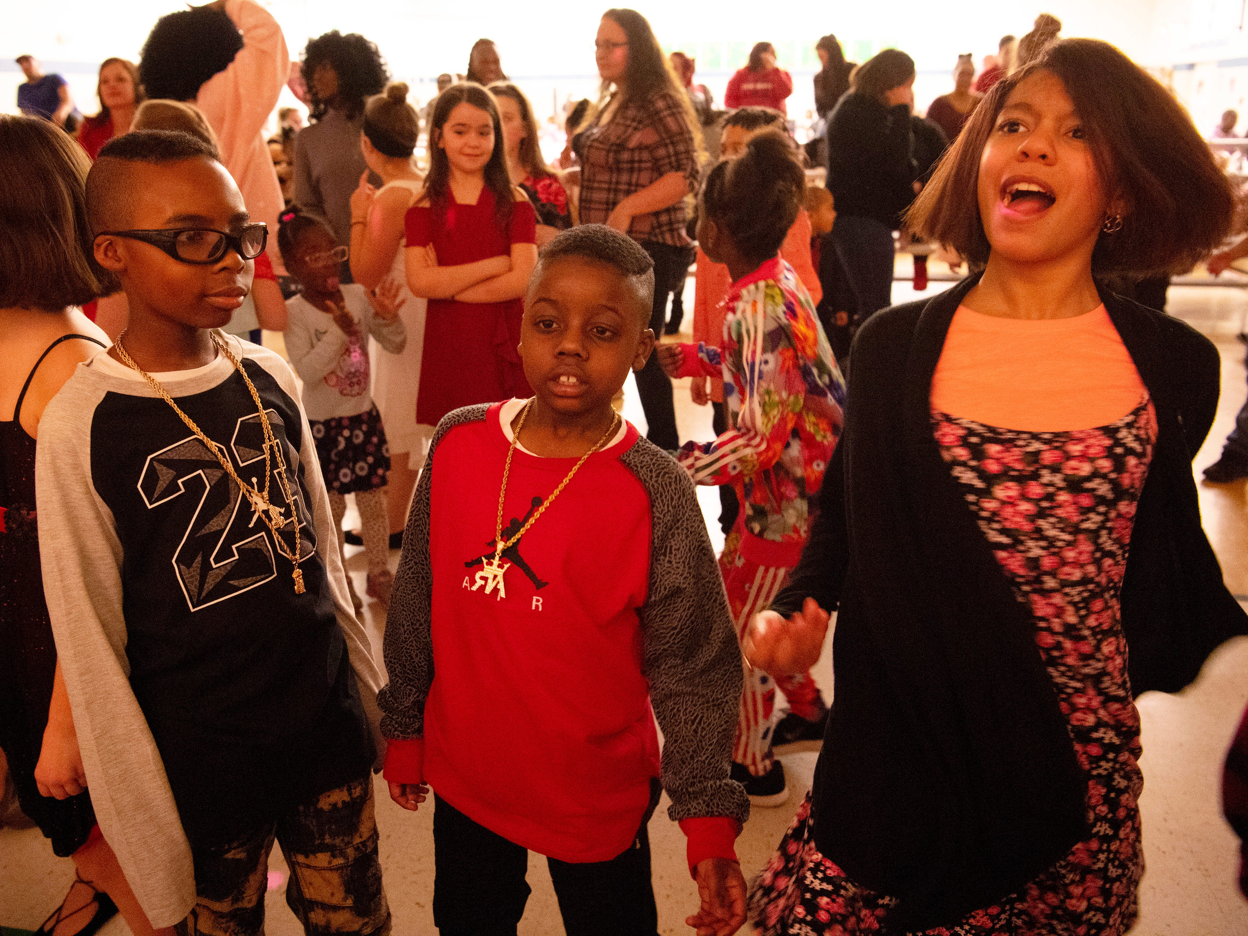 """Caze Elementary School students dance to """"The Wobble"""" at the Sweetheart Dance Tuesday night."""