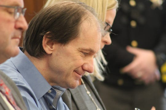 Daniel Myers cracks a smile during his plea hearing. He was sentenced Wednesday to life in prison without parole for the 2015 murder of Heather Bogle.