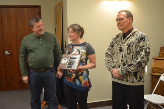 Clydescope Board President Steve Spader,left, and Clydescope Director Bill Brown, right, presented Main Street Café owner Beth Powers with a plaque of appreciation during Clydecope's January meeting. The group meets monthly at the café.