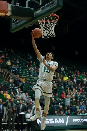 Colorado State University junior guard Anthony Masinton-Bonner (15) makes an easy layup after snagging a lost ball during a game against San Diego State University on Tuesday, Feb. 12, 2019, at Moby Arena in Fort Collins, Colo.