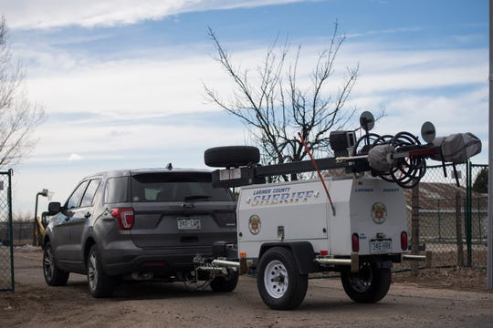 A Larimer County Sheriff's Department vehicle brings in a mobile security camera station as crews work to demolish a house and garage deemed to be posing a public safety threat to the surrounding neighborhood due in part to hazardous levels of methamphetamines on Wednesday, Feb. 13, 2019, in Loveland, Colo.