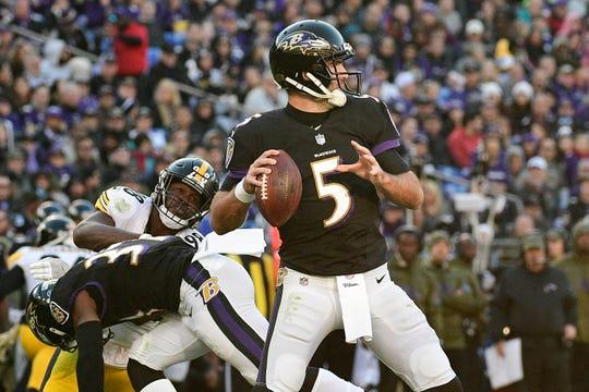 Nov 4, 2018; Baltimore, MD, USA;  Baltimore Ravens quarterback Joe Flacco (5) throws as  running back Javorius Allen (37) blocks Pittsburgh Steelers cornerback Mike Hilton (28) during the third quarter at M&T Bank Stadium. Mandatory Credit: Tommy Gilligan-USA TODAY Sports