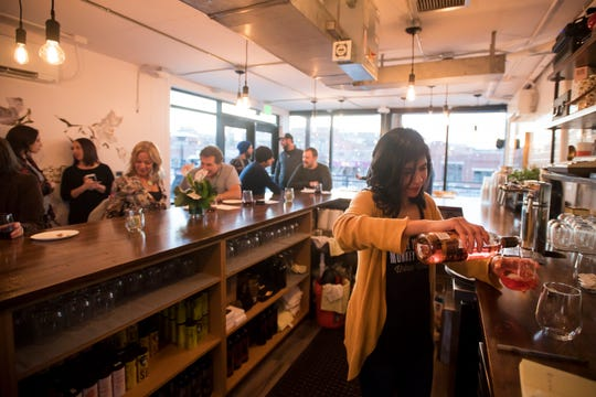 Bartender Liz Ortiz pours a glass of the bottled rosé on Tuesday, Feb. 12, 2019, during the soft opening at The Infinite Monkey Theorem in Fort Collins, Colo.