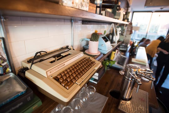 Vintage type writers and cash are displayed behind the bar on Tuesday, Feb. 12, 2019, during the soft opening at The Infinite Monkey Theorem in Fort Collins, Colo.