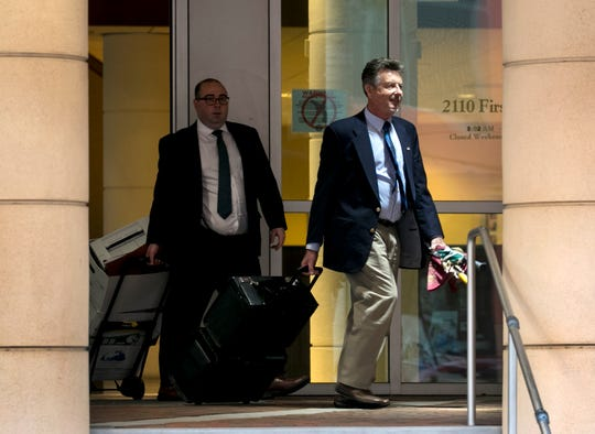 Accompanied by Attorney Matthew Goddeyne, John G. Williams Jr., right, leaves the U.S. District Courthouse in downtown Fort Myers Williams Jr., is accused along with Robert and Kay Gow of conspiracy and fraud in the use of $4.7 million in Lee County economic development funds