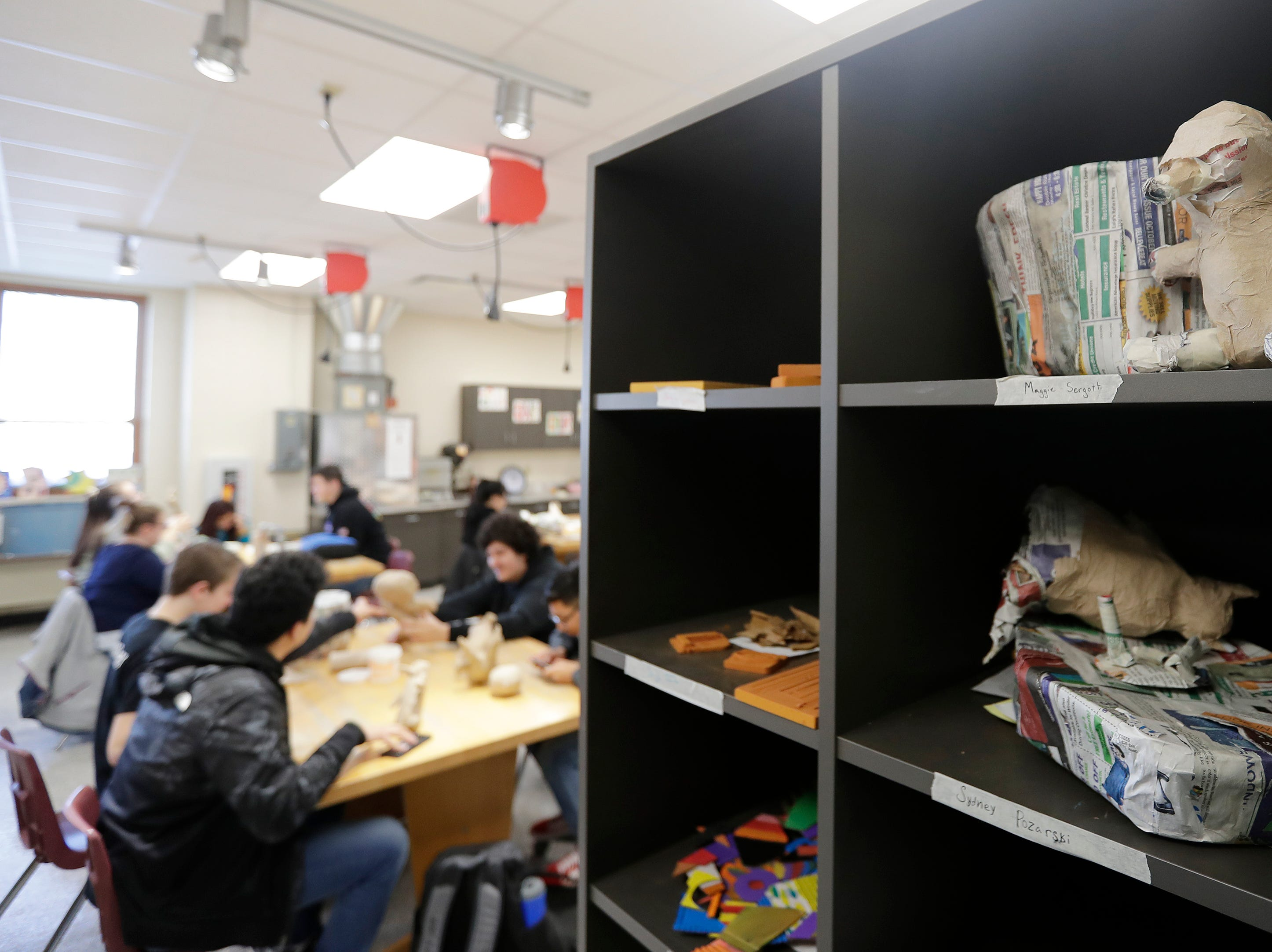 New storage space for student art projects is part of a remodeled art classroom at East High School in Green Bay.