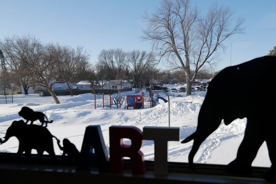 New playground equipment is seen from the art classroom at Webster Elementary on Wednesday in Allouez.