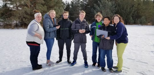 Washington Island eighth-grade students, a science teacher and team coach pose for a photo February 2019. They are science teacher Jessica Dennis, left, Breanna McGrane, Spencer Johnson, Aidan Purinton, Jake Kooiker, Joseph Lux, and coach Miranda Dahlke, a science, math and English teacher in the Washington Island School District. The students are holding the electronic and wireless supplies awarded after they were won the state title in the first phase of the Samsung Solve for Tomorrow national competition.