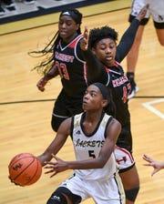 TL Hanna junior Carmen Chandler(5) shoots near Hillcrest senior Kiara Banks during the fourth quarter at T.L.Hanna High School in Anderson on Tuesday.