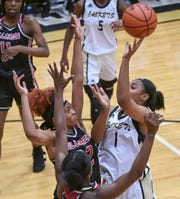 TL Hanna junior DeAsia Marshall(1) shoots around Hillcrest junior Ayonnah Harris during the fourth quarter at T.L.Hanna High School in Anderson on Tuesday.