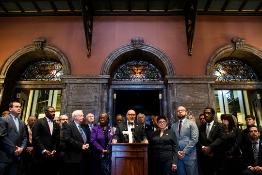 Republican and Democratic lawmakers stand beside Rep. Alan Clemmons, R-Myrtle Beach, as he introduces a bill to reform civil asset forfeiture laws at the Statehouse on Wednesday, Feb. 13, 2019.