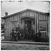 Ely Parker, second from the right, with Gen. Grant's staff at City Point, Va., during the Civil War.