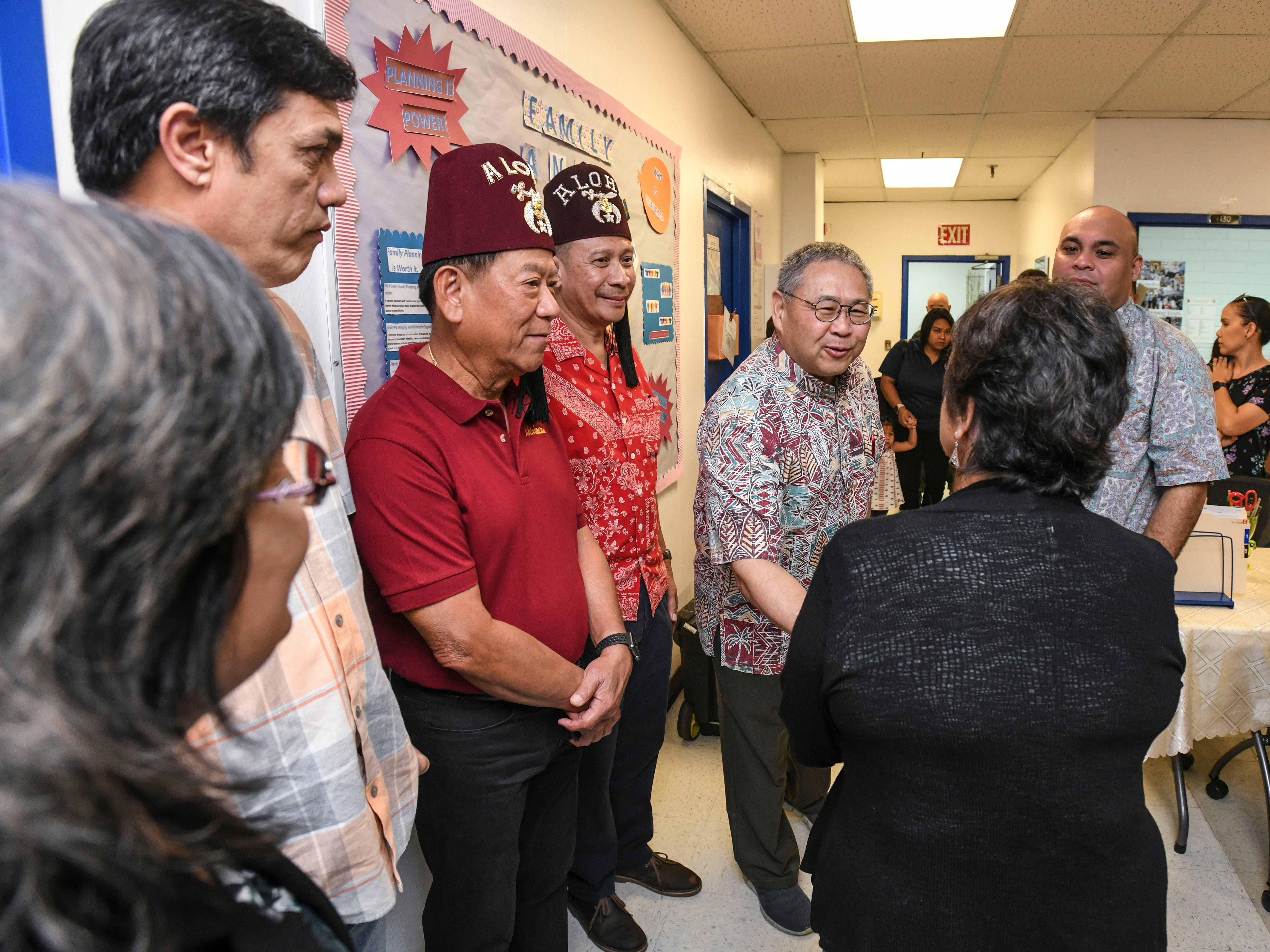 Dr. Craig Ono, Shriner's Hospital for Children chief of staff, is greeted by Gov. Lou Leon Guerrero and Lt. Gov. Josh Tenorio, during their visit to the Department of Public Health and Social Services in Mangilao on Wednesday, Feb. 13, 2019. Ono, who is conducting a five-day medical outreach at the center, is hoping to see and treat about 200 of the island's younger population during his visit, Sandy Zukeran, outreach coordinator said.