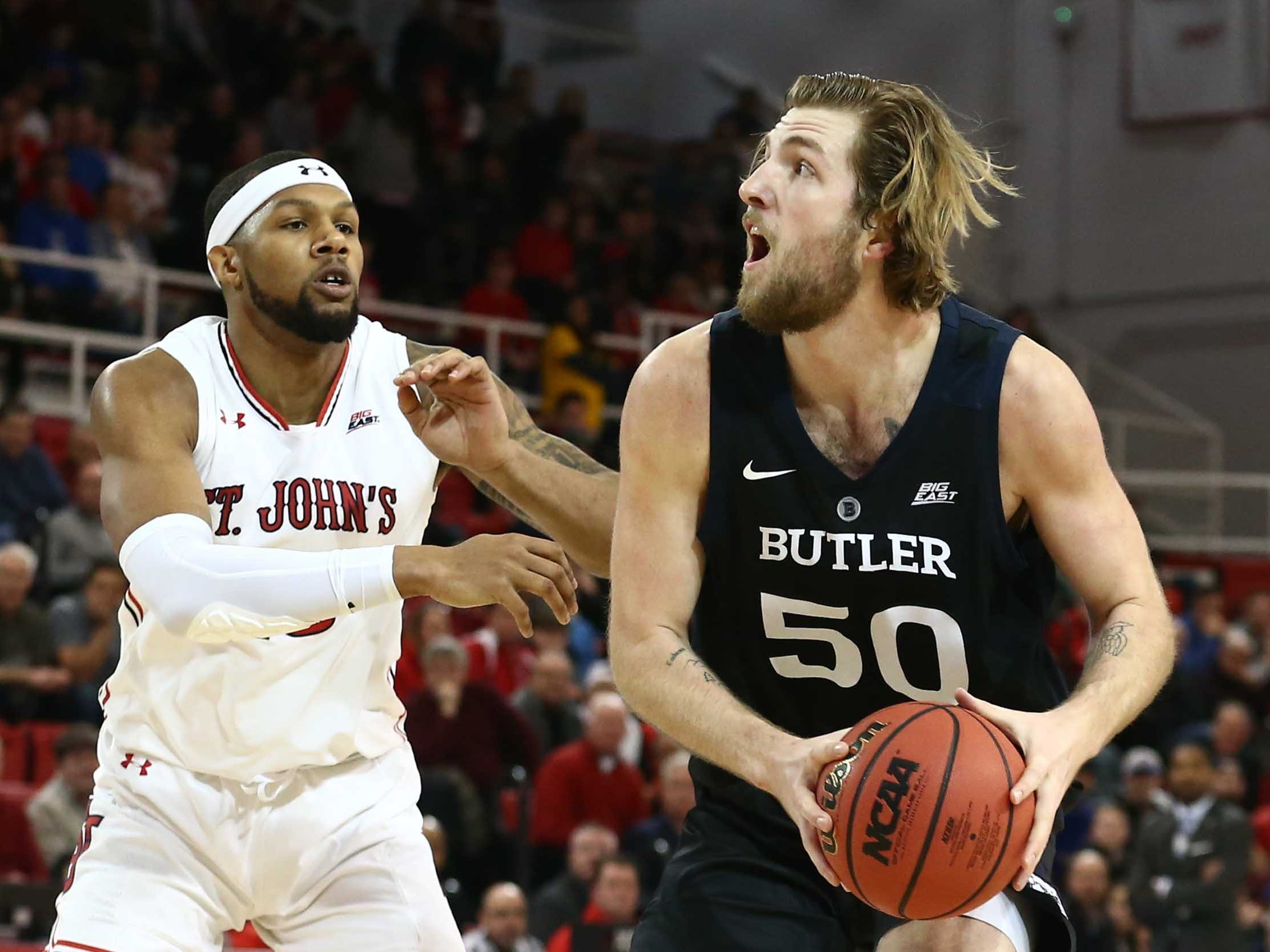 Feb 12, 2019; Queens, NY, USA; St. John's Red Storm forward Marvin Clark II (13) defends against Butler Bulldogs forward Joey Brunk (50) in the first half at Carnesecca Arena.