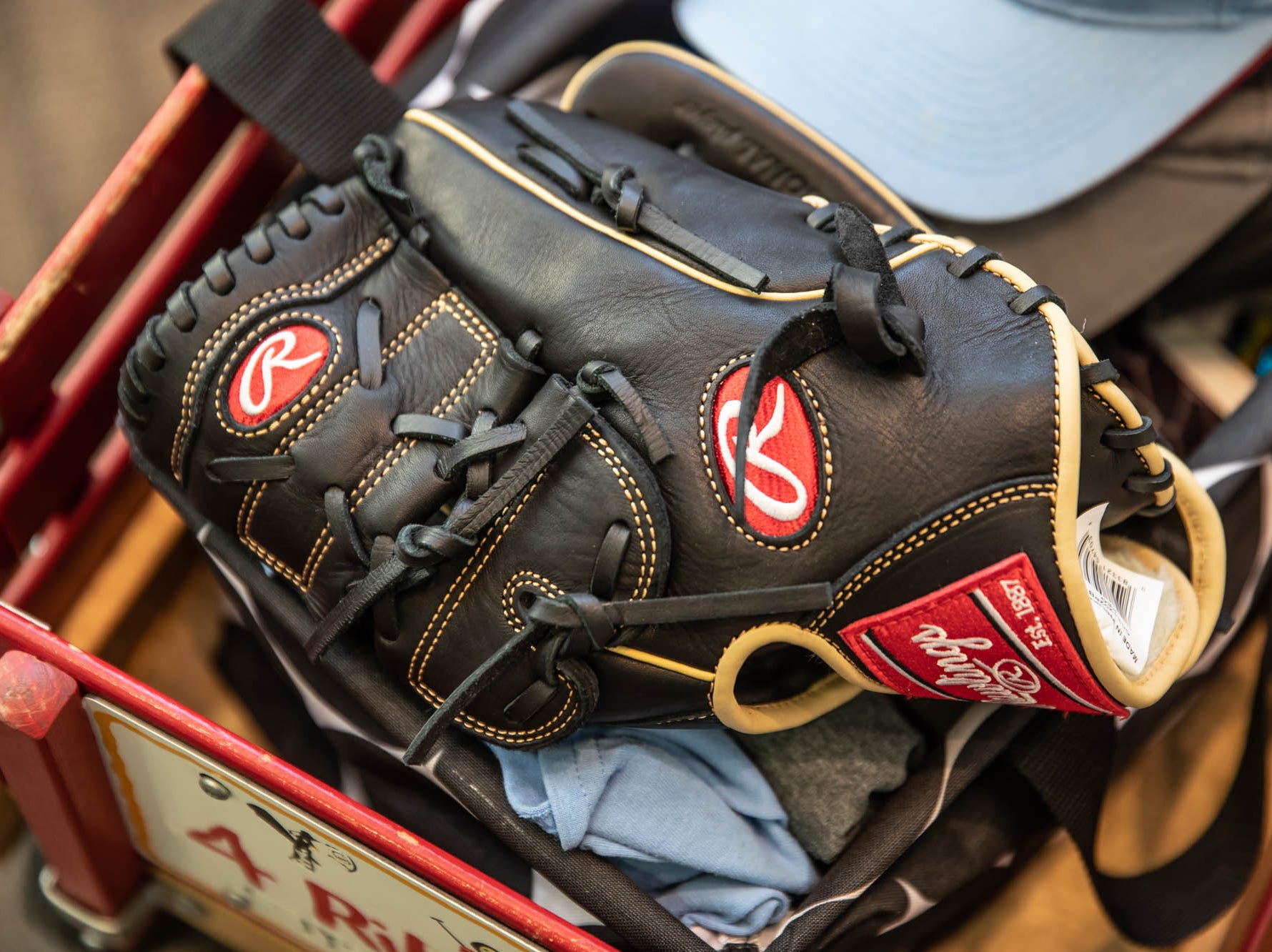 Britton Helmuth's baseball glove waits for him in a wagon at Riley Hospital for Children. After his second heart surgery, Britton has been cleared to play baseball again.