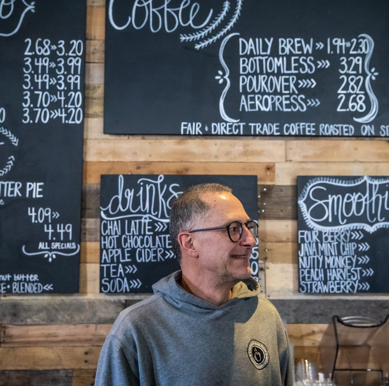 Brian Peters, owner of Coffeehouse Five, poses...