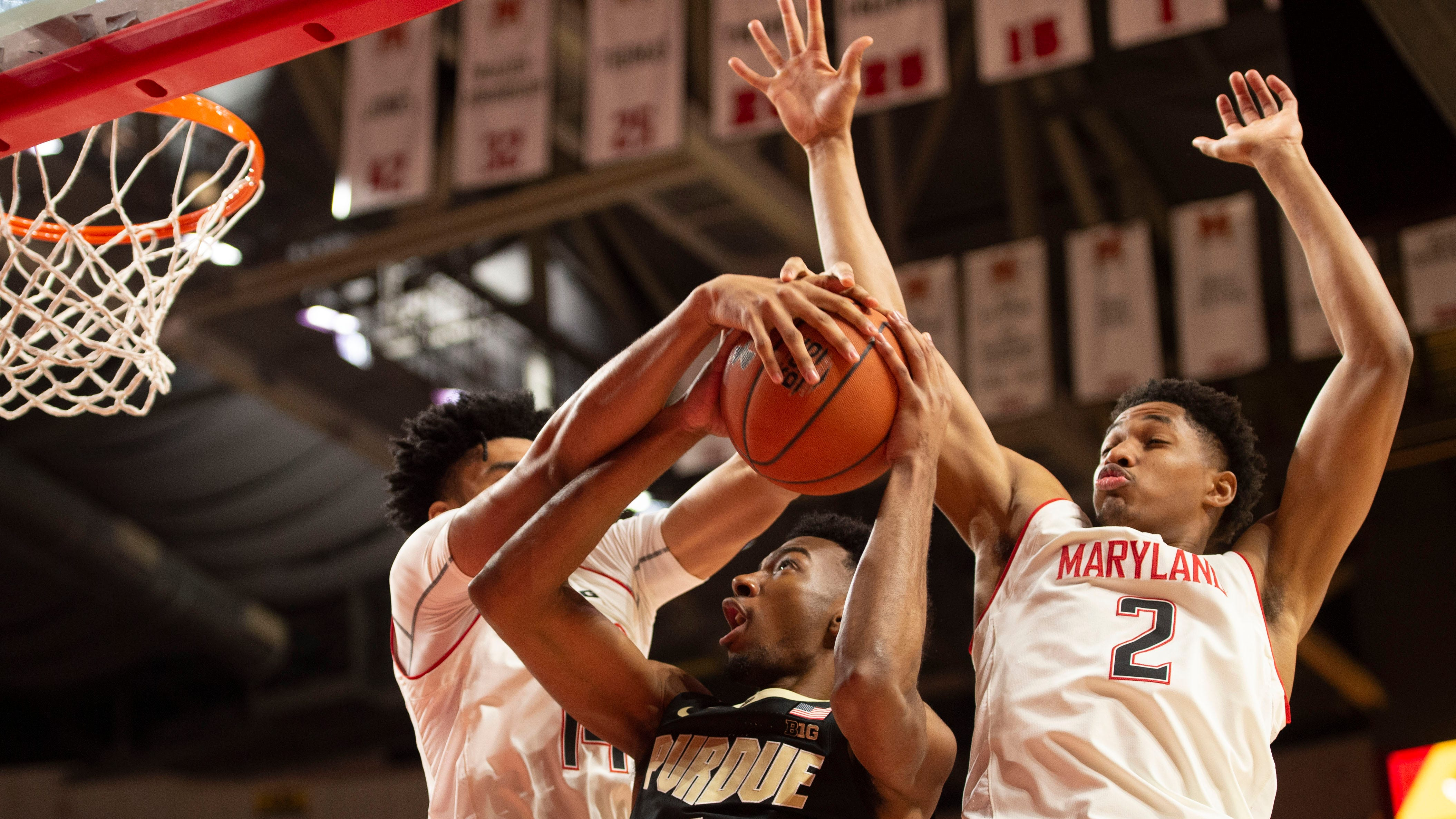 Feb 12, 2019; College Park, MD, USA; Maryland Terrapins forward Ricky Lindo Jr. (14) and  guard Aaron Wiggins (2) defend Purdue Boilermakers forward Aaron Wheeler (1) shot during the first half at XFINITY Center.