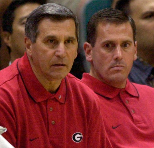 Georgia coach Jim Harrick, left, and the 2001 Bulldogs are the only team in the last 25 years to make the tournament with a record less than four games above .500.