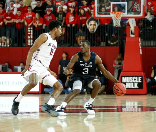 Feb 12, 2019; Queens, NY, USA; St. John's Red Storm guard Justin Simon (5) defends against Butler Bulldogs guard Kamar Baldwin (3) in the first half at Carnesecca Arena.