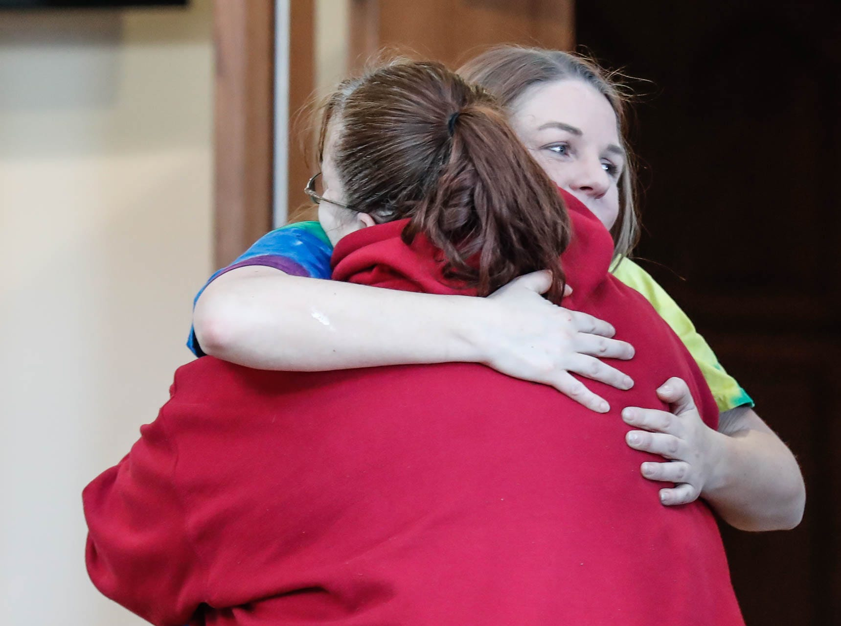 Anna Williams, left, the mother of Abby Williams, hugs relative Kelli Munsterman, right,