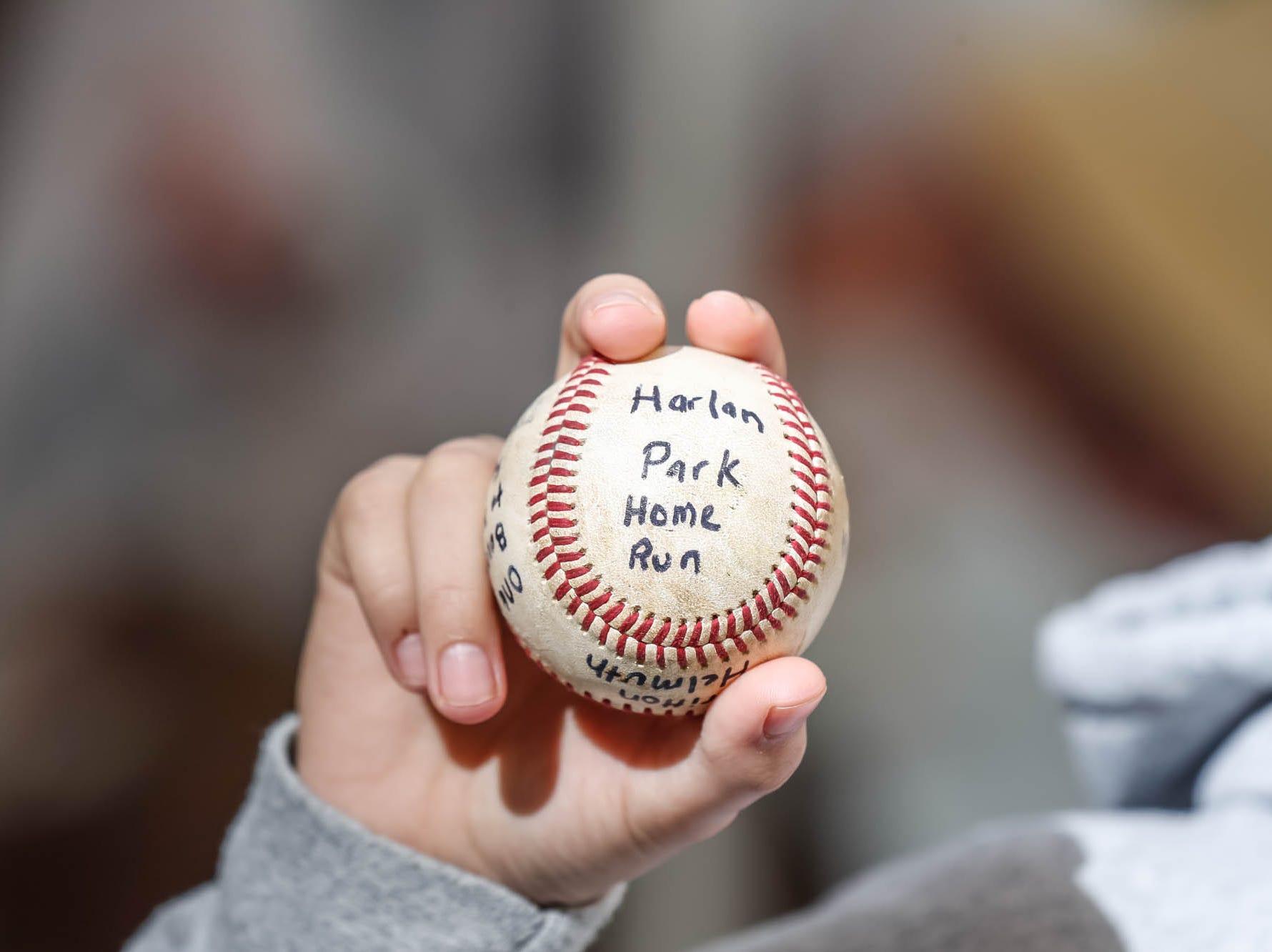 Britton Helmuth displays his Harlan Park home run baseball.