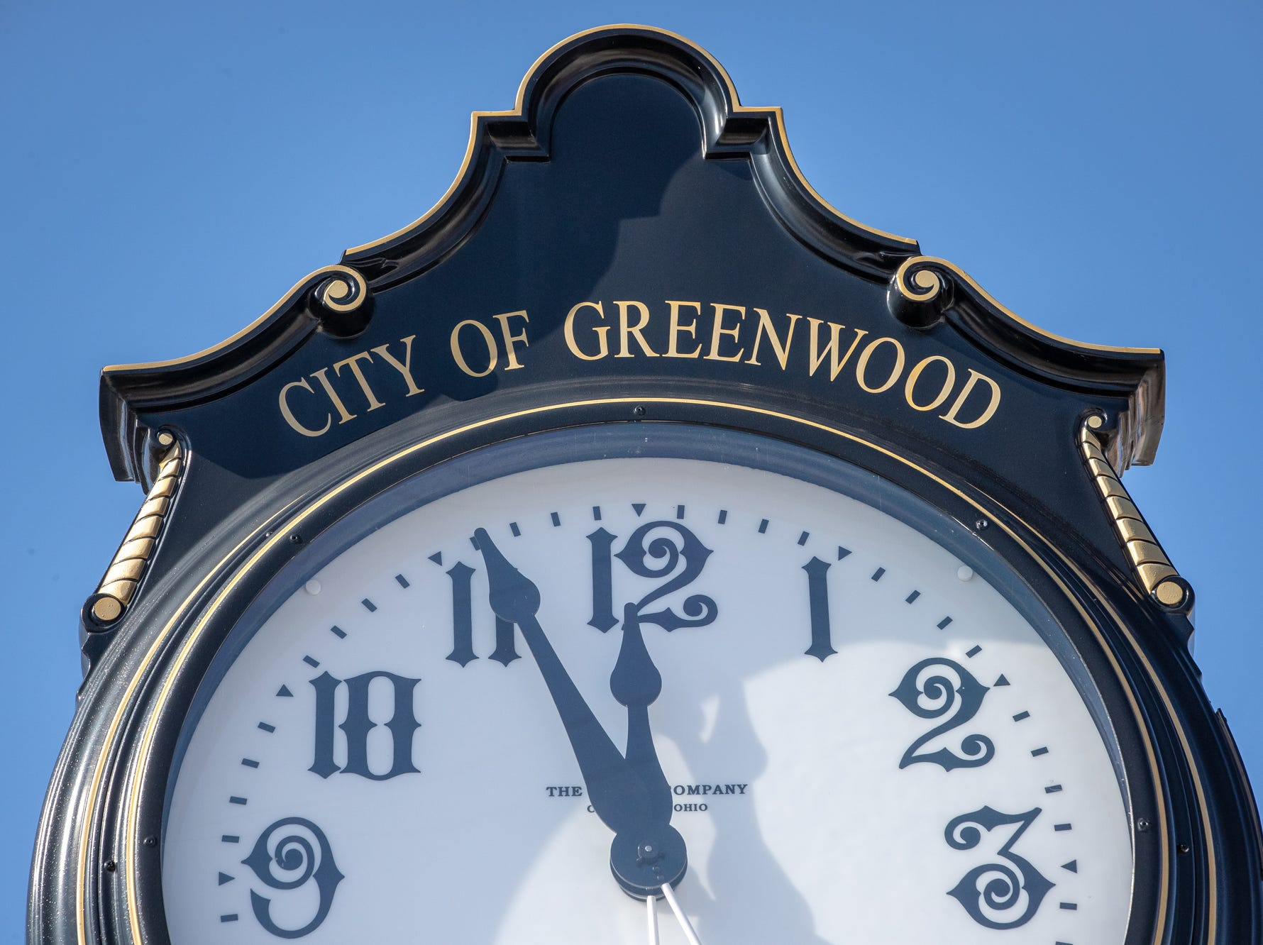 A City of Greenwood clock sits on Main Street on Wednesday, Feb. 13, 2019.