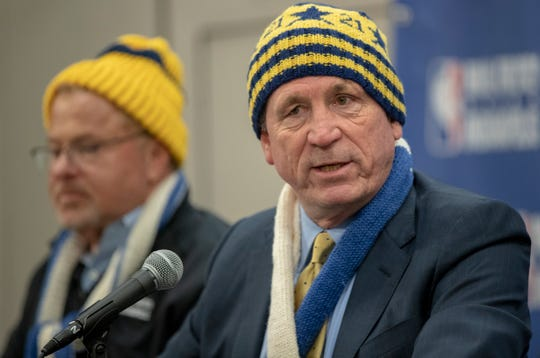 "Eddie White, left, listens as Pacers Sports & Entertainment president Rick Fuson unveils the ""Nothing But Knit"" project Wednesday at Bankers Life Fieldhouse."