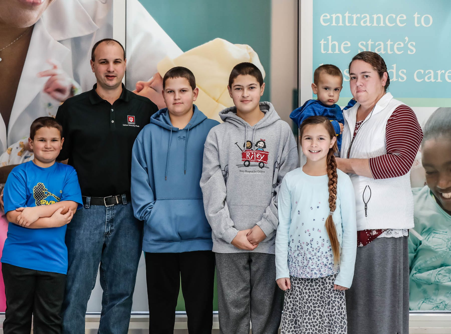 The Helmuth family poses for a photo at Riley Hospital for Children on Jan. 13. From left: Gabriel, Myron, Chandler, Britton, Madalyn, Zayne and Laura.
