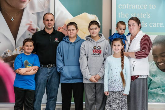 The Helmuth family poses for a photo at Riley Hospital for Children at IU Health,. Left to right: Gabriel, Myron, Chandler, Britton, Madalyn, Zayne, Laura.