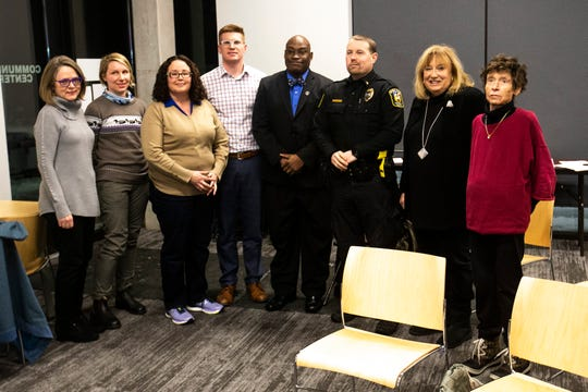 University Heights Councilors (from left) Liesa Moore, Virginia Miller, Silvia Quezada, Nick Herbold, Iowa City NAACP President Kevin Sanders, Police Chief Nate Petersen, Louise From, and Dotti Maher pose for a photo during a city council meeting on Tuesday, Feb. 12, 2019 inside the Community Center at One University Place in University Heights, Iowa. University Heights city council approved a ban on racial and other forms of profiling by the police department.