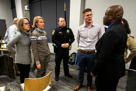 University Heights Councilors and Police Chief Nate Petersen meet with Iowa City NAACP President Kevin Sanders, far right, during a city council meeting on Tuesday, Feb. 12, 2019 inside the Community Center at One University Place in University Heights, Iowa. University Heights city council approved a ban on racial and other forms of profiling by the police department.