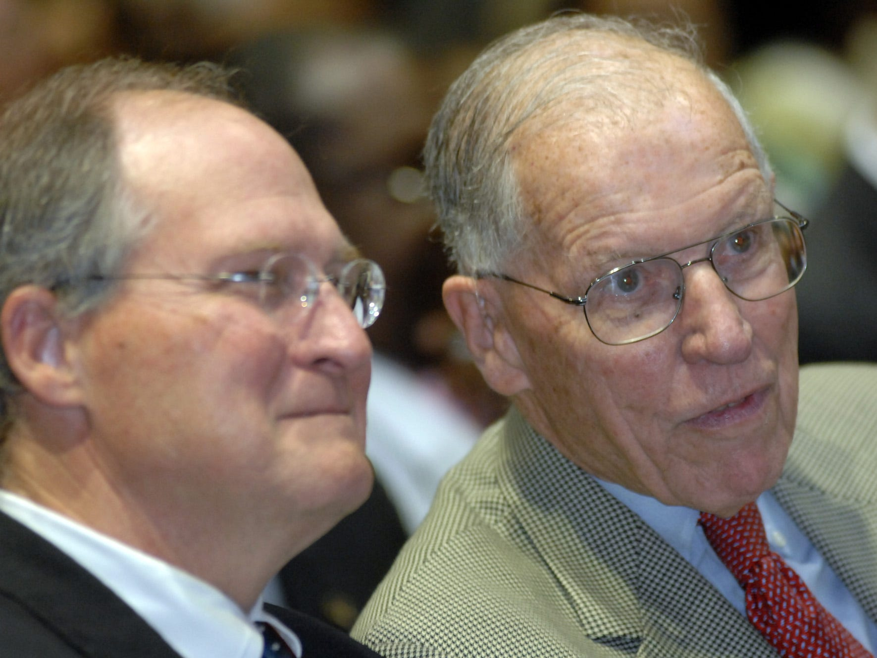 Former Gov. William Winter (right) and Bill Waller Jr. chat while waiting for the city of Jackson inaugural ceremony to begin.