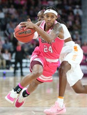 Mississippi State senior guard Jordan Danberry drives by a Tennessee defender. Danberry had 20 points in State's win over the Lady Volunteers.
