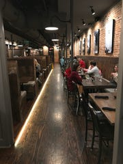 Genna Benna's restaurant features a mix of tables and chairs and oversized booths.
