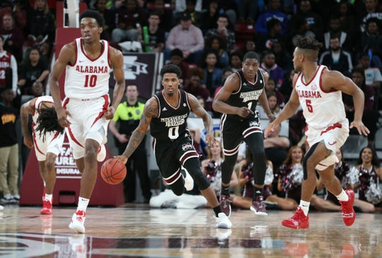 Mississippi State sophomore guard Nick Weatherspoon races by Alabama defenders on Tuesday Feb. 12 at Humphrey Coliseum.