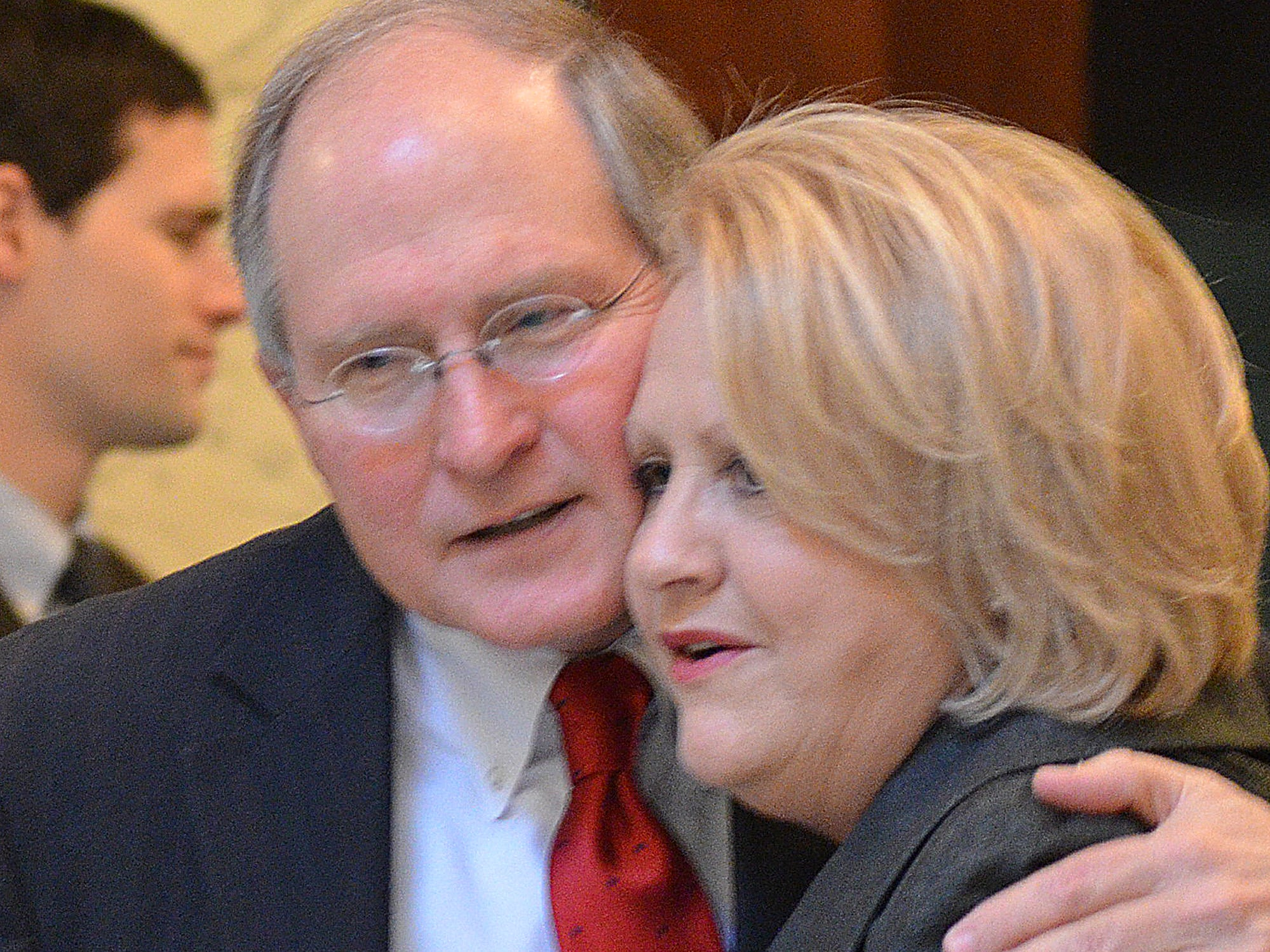 Bill Waller Jr. and his first cousin Susan Waller Vaughn give each other a hug in the Capitol Rotunda where his father Gov. Bill Waller lies in state.
