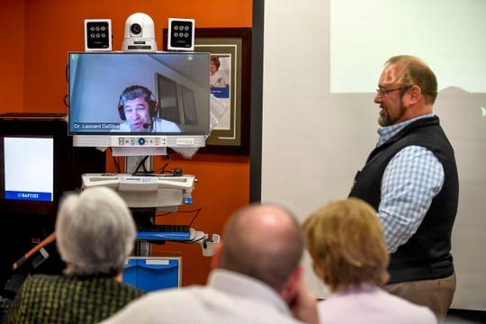 Michael Cupples, right, presents a telemedicine machine at Baptist Memorial Hospital in Huntingdon on Feb. 8, 2019.