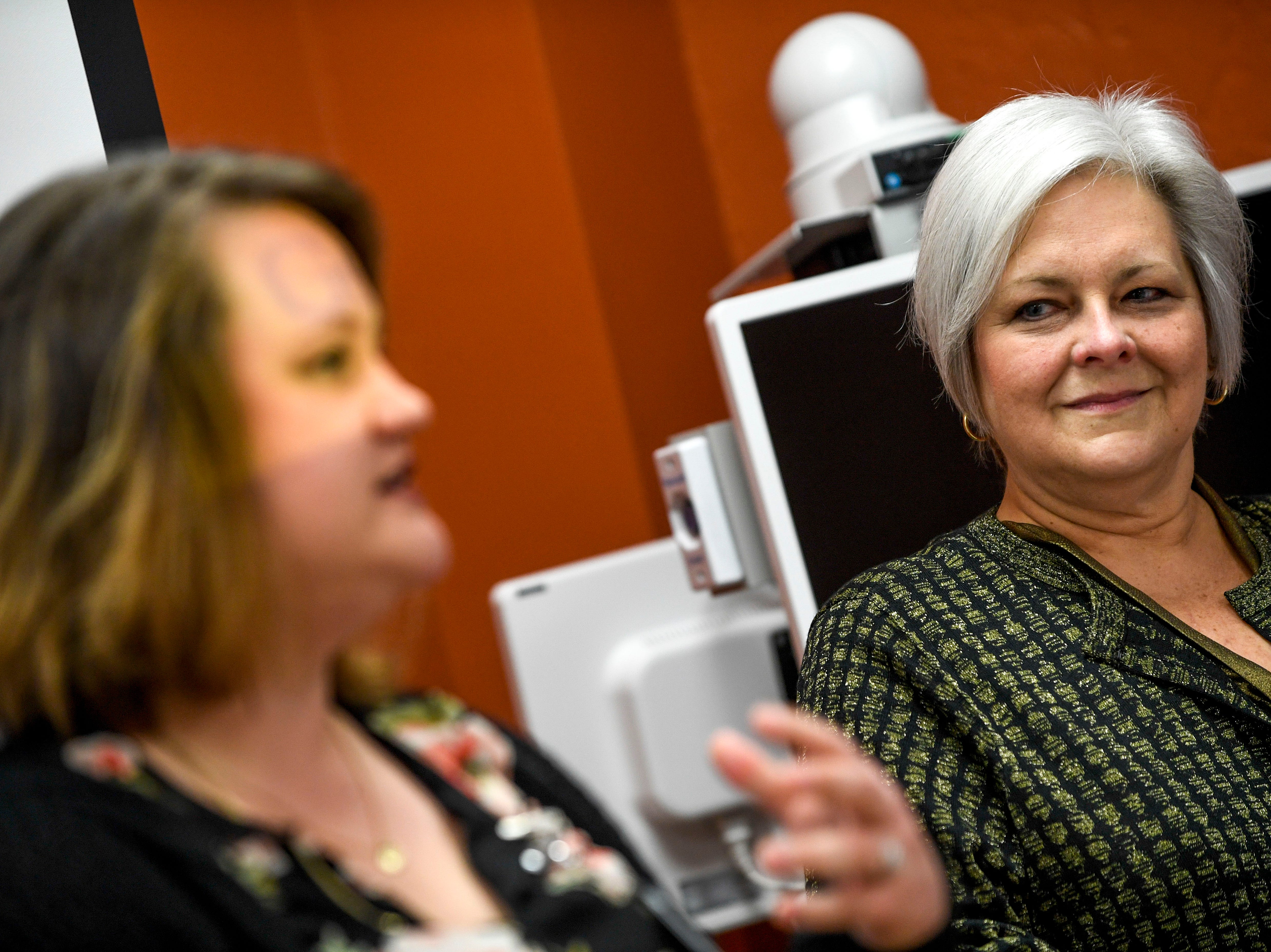 Susan Breeden listens to Joanna Smith, left, present information about a device that can stream a doctor from a remote location to evaluate patients   at Baptist Memorial Hospital in Huntingdon, Tenn., on Friday, Feb. 8, 2019.