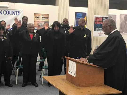 Judge Nathan Pride swears in the 2019-2020 officers and executive members of the Jackson Madison County NAACP branch at the NAACP Founders Day celebration at the Jackson Madison County branch's headquarters in Jackson, Tenn. on Feb. 12.