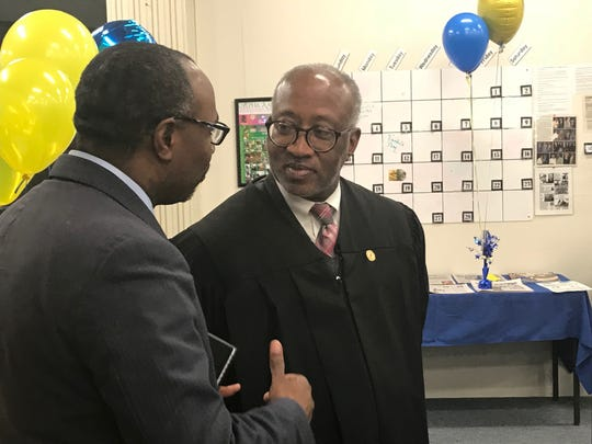 Pastor Curtis Mormon speaks with Judge Nathan Pride at the NAACP Founders Day celebration at the Jackson Madison County branch's headquarters in Jackson, Tenn. on Feb. 12.