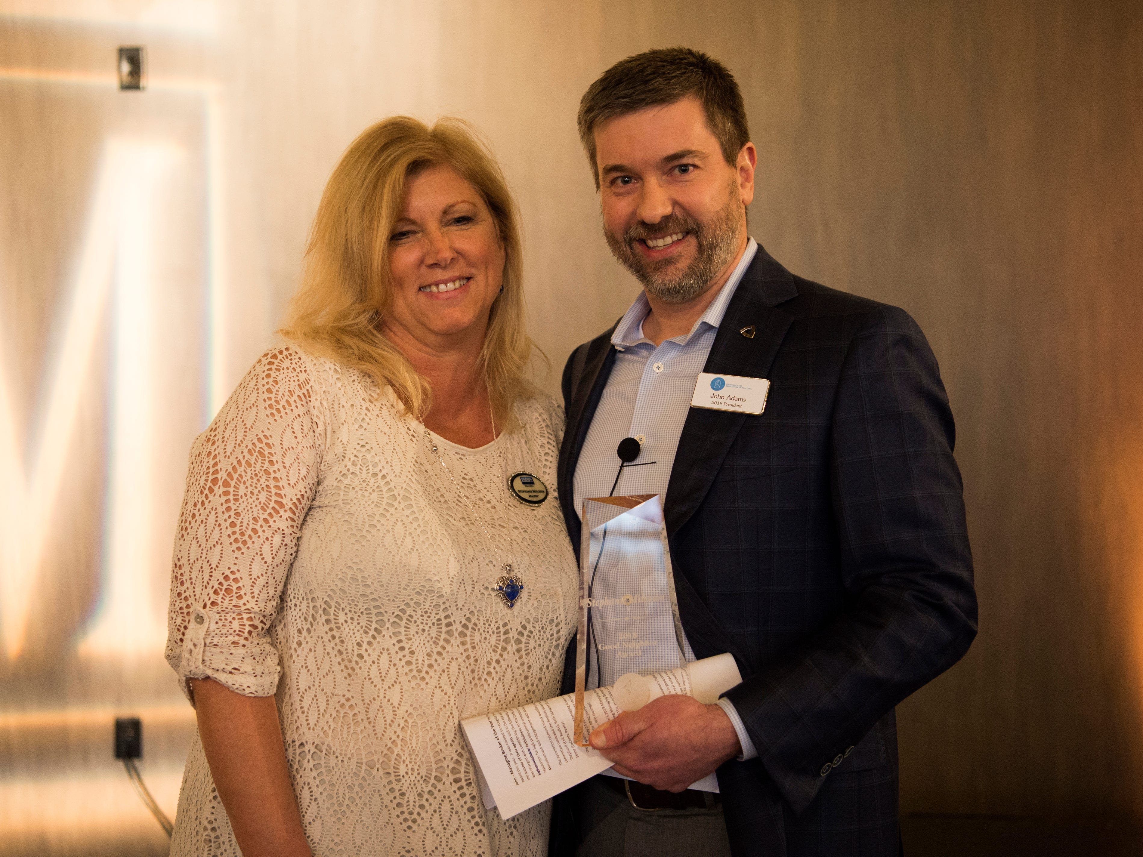 Stephanie Mitchum, left, is awarded Good Neighbor at the Commercial and Residential Real Estate Awards held at The Press Room in Knoxville on Tuesday, February 12, 2019.
