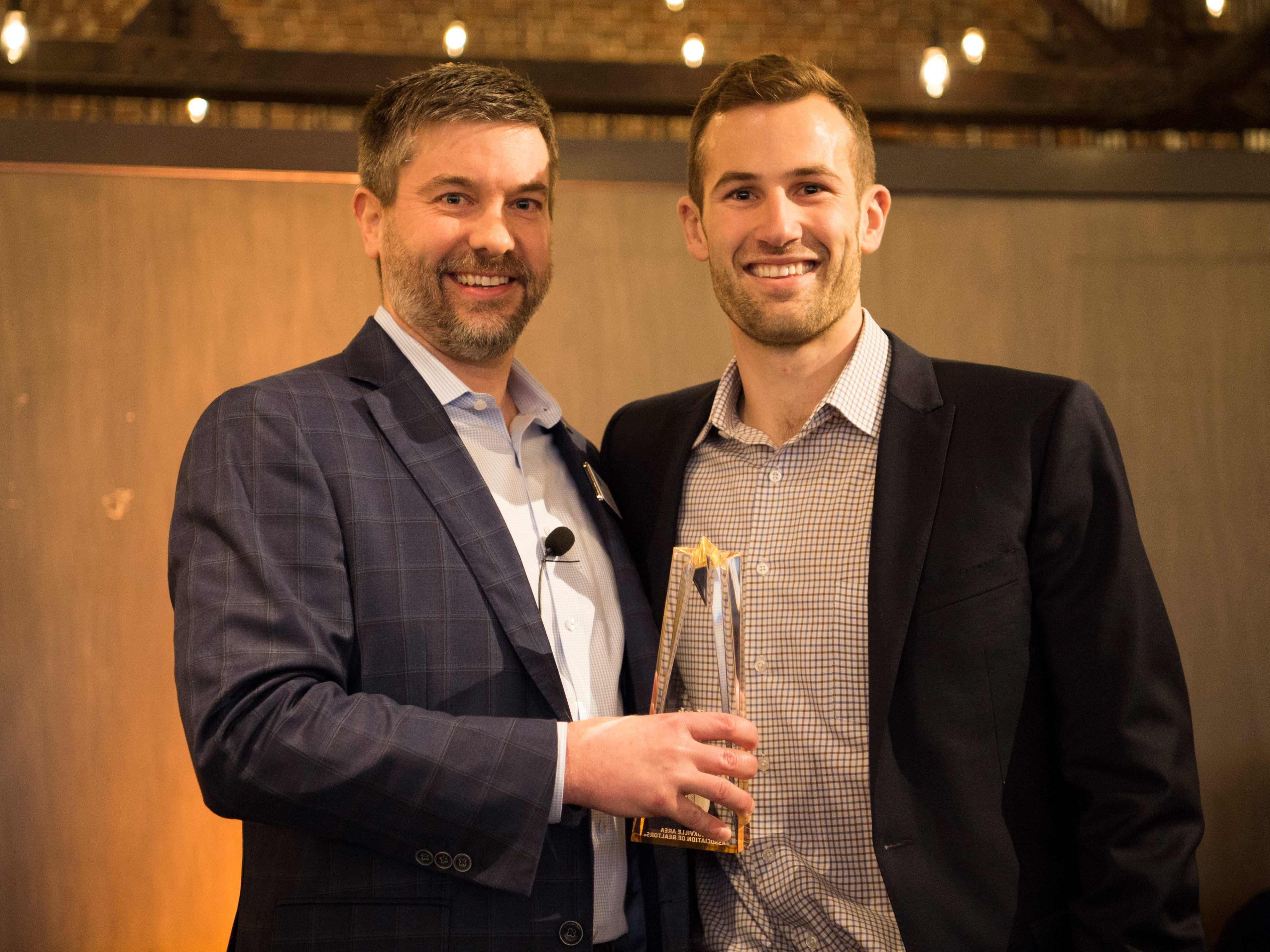 Zach Sale, right, is awarded Rising Star at the Commercial and Residential Real Estate Awards held at The Press Room in Knoxville on Tuesday, February 12, 2019.