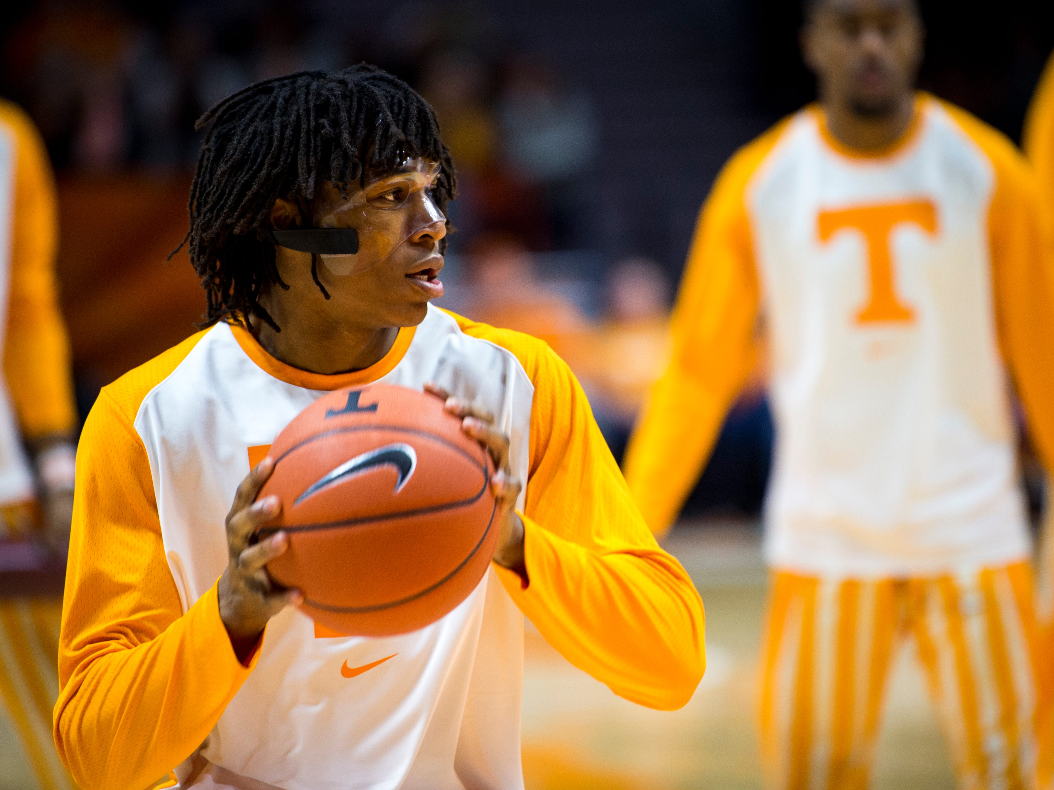 Tennessee guard/forward Yves Pons (35) wears a face mask before Tennessee's home SEC game against South Carolina at Thompson-Boling Arena in Knoxville on Wednesday, February 13, 2019.