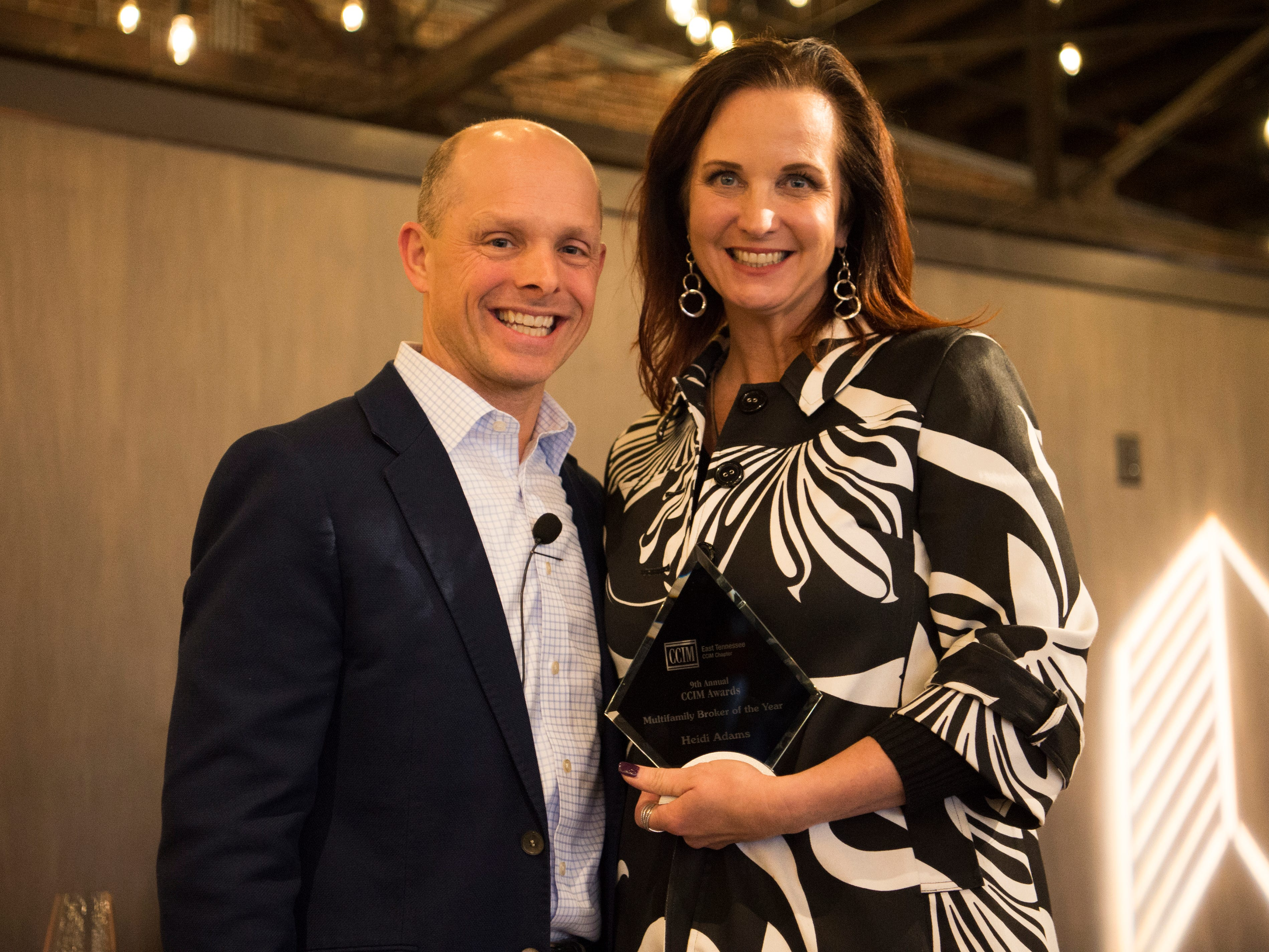 Heidi Adams, right, is awarded Multifamily Broker of the Year at the Commercial and Residential Real Estate Awards held at The Press Room in Knoxville on Tuesday, February 12, 2019.