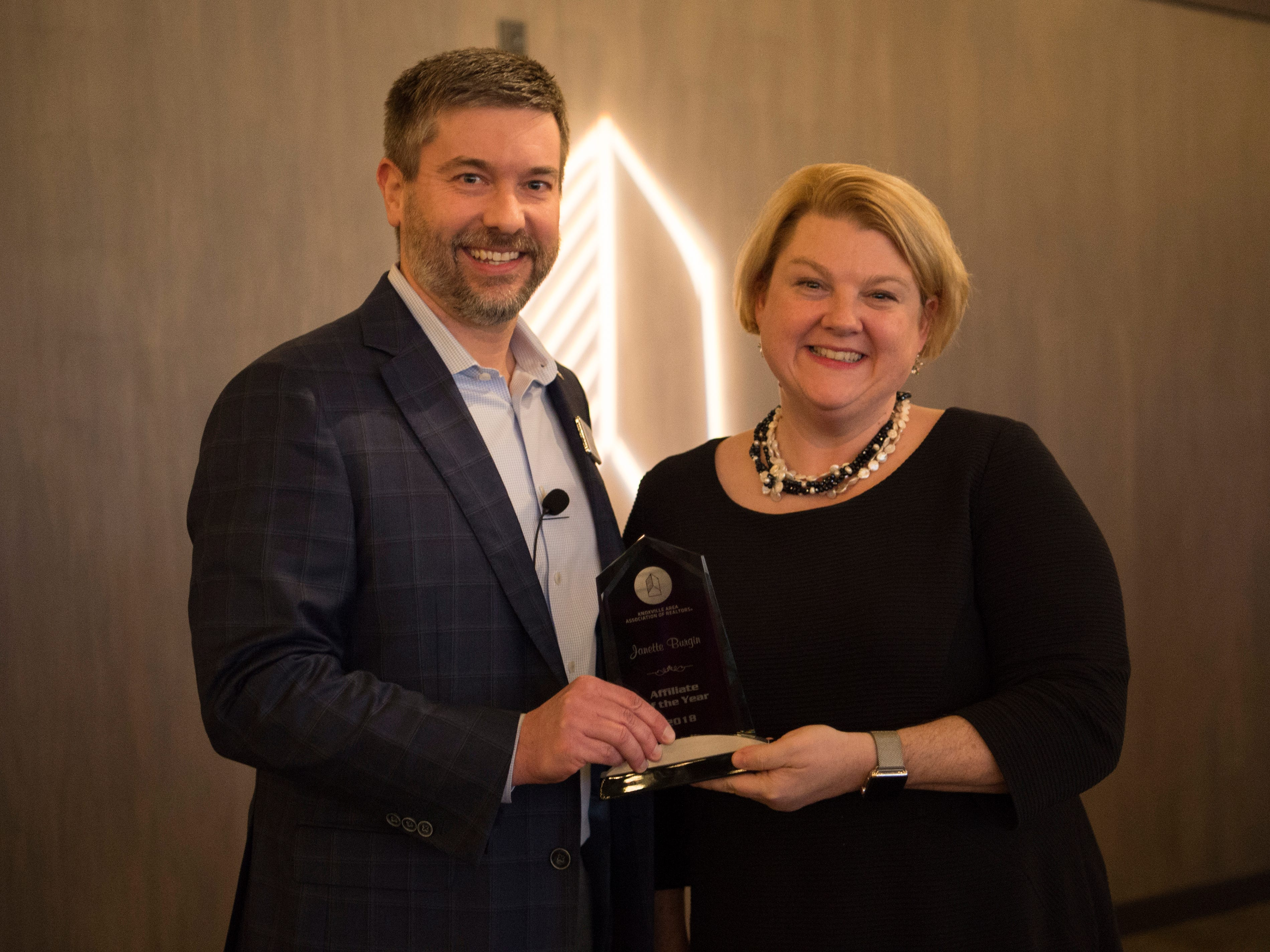 Janette Burgin, right, is awarded Affiliate of the Year at the Commercial and Residential Real Estate Awards held at The Press Room in Knoxville on Tuesday, February 12, 2019.